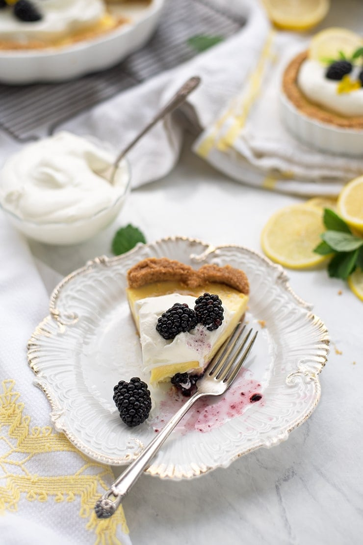 Lemon Icebox Pie is just what summer ordered! This recipe is sweet, tart, creamy, and best served cold! Perfect for when the thermometer soars!