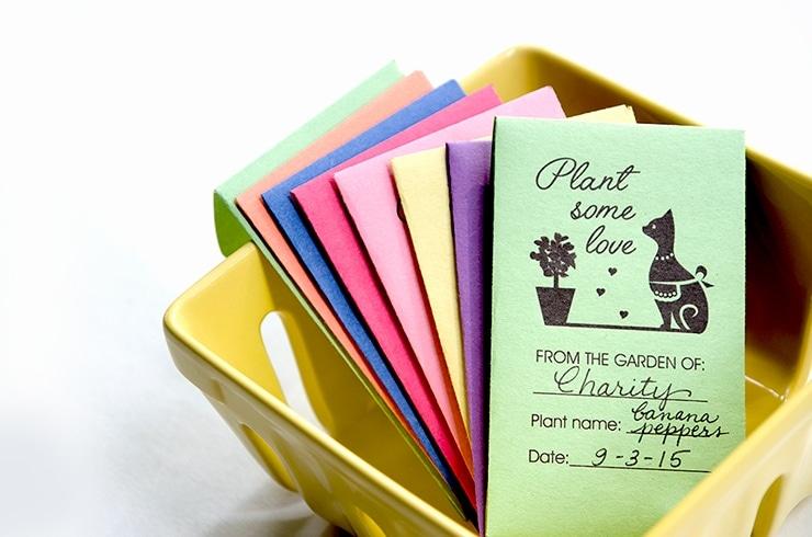 colored seed envelopes in ceramic fruit basket