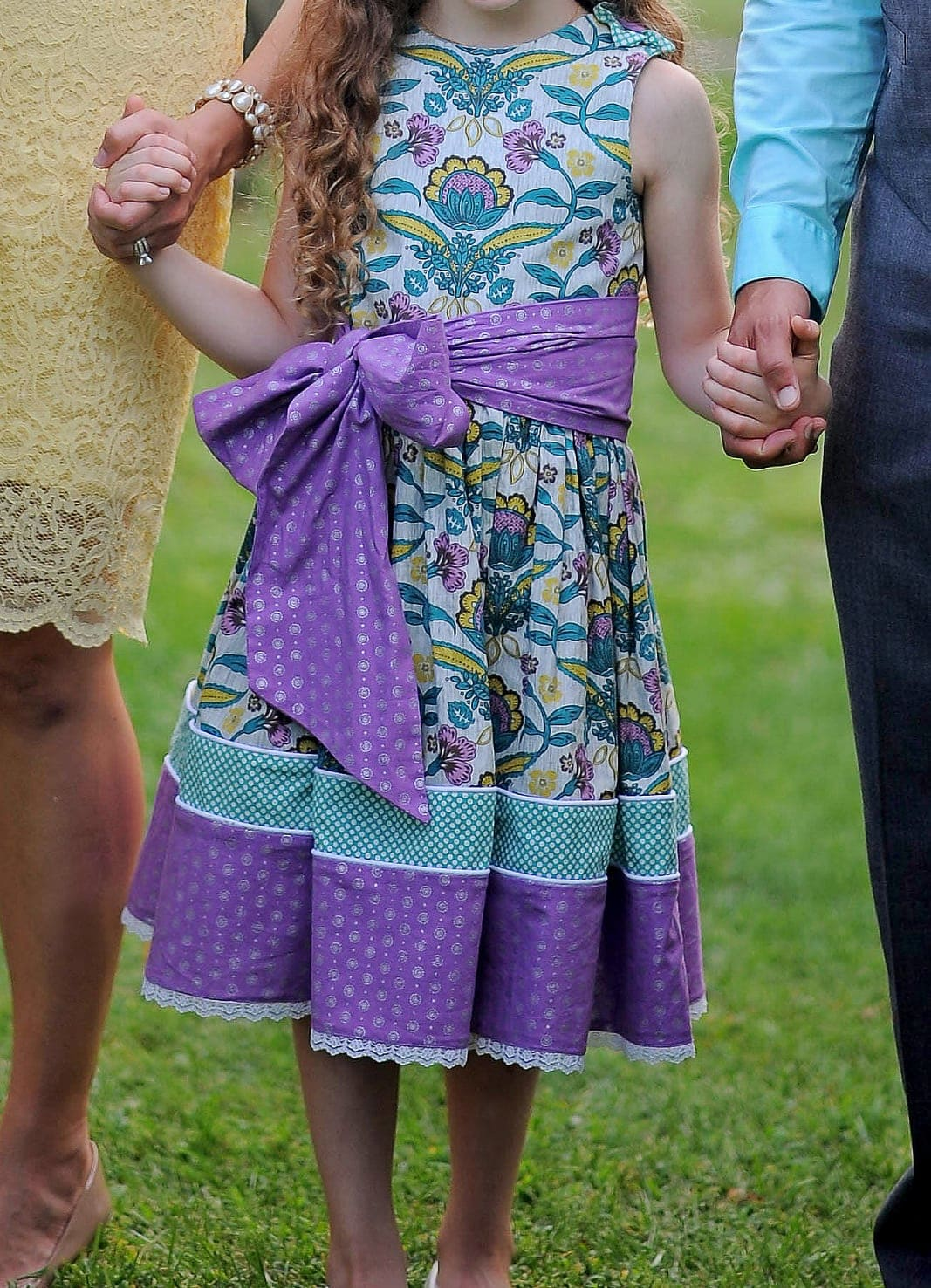 Special occasions are the perfect time to get creative with fabrics. These dresses and accessories were custom designed to create a whimsical and cohesive look for a family's Adoption Day celebration! Photos: http://www.amandamcmahonblog.com | Dress design: vintagekitty.com