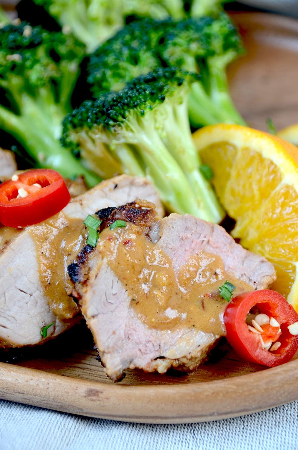 Pork tenderloin covered in peanut sauce