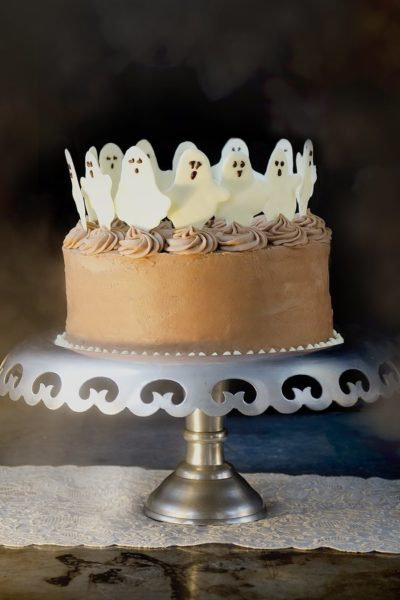 Dancing ghosts have to be the cutest Halloween cake toppers EVER! But you will love the taste of this confection too. Mocha coconut buttercream tops layers of rich, fudgey chocolate coconut cake. HAUNTINGLY DELICIOUS!