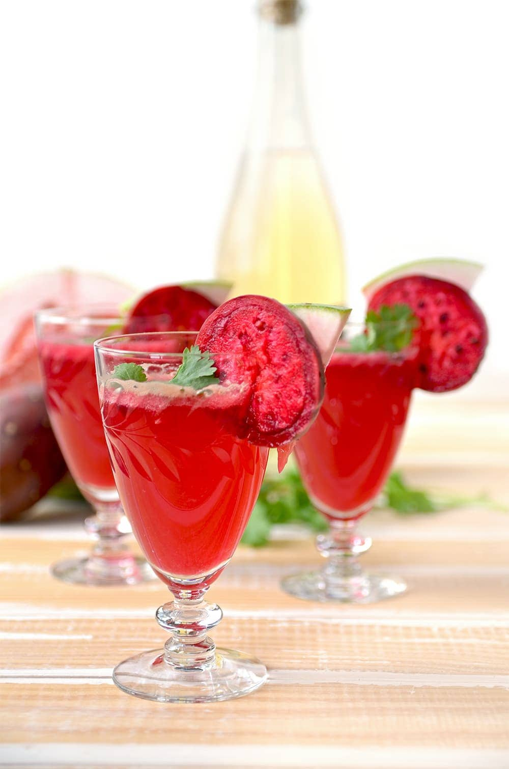 Refreshing, fruity and unique, this Prickly Pear Hard Cider Cocktail with Cilantro and Pomelo tastes as yummy and bright as it looks. | vintagekitty.com