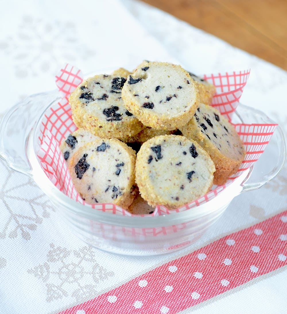 Blueberry Lime Shortbread is a great holiday icebox cookie. It's filled with dried blueberries and lime zest giving it a fresh, zippy flavor and coated in an almond cornmeal crumb for added texture and crunch. | vintagekitty.com