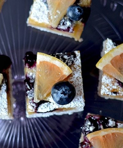 Blueberry Grapefruit Bars are a perfect warm weather dessert that is sweet, refreshing, tart, buttery and best served cold. Scratch baking at it's best! | vintagekitty.com