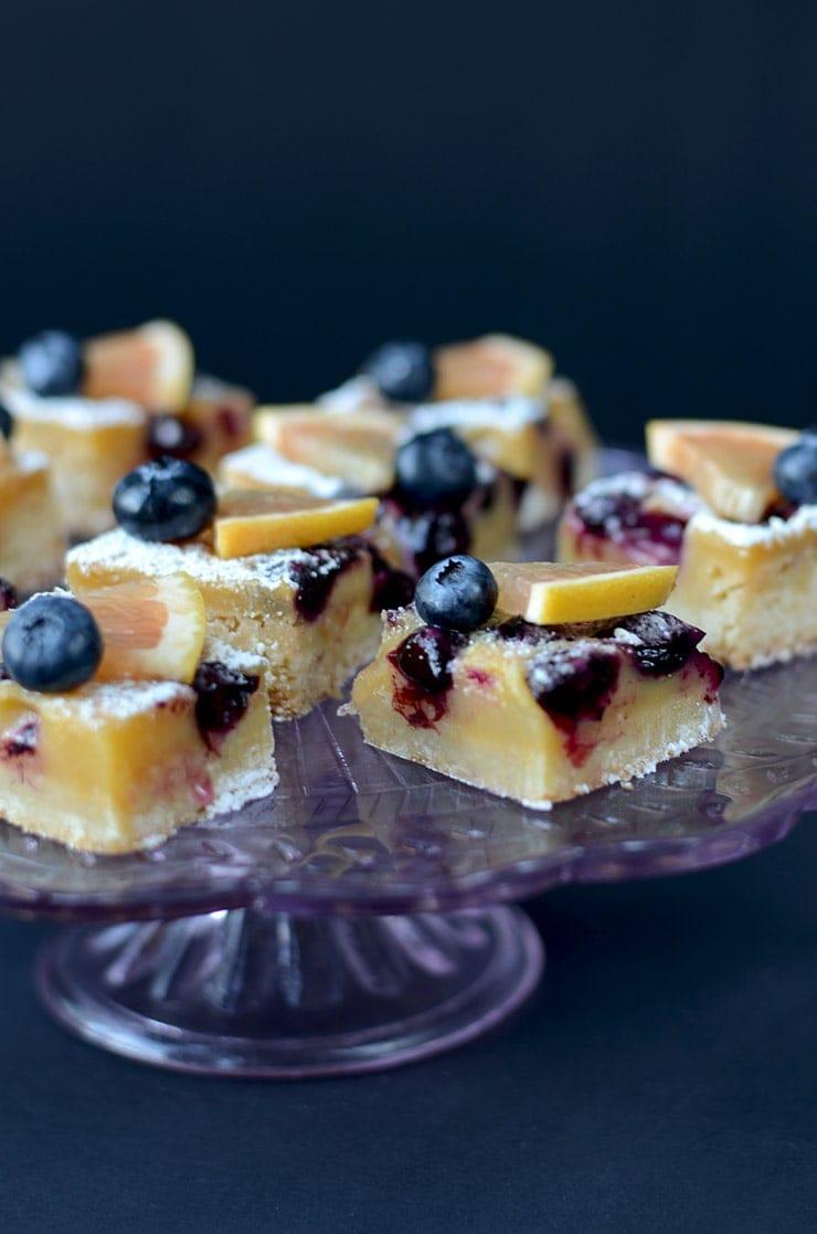 Blueberry Grapefruit Bars on Cake Pedestal Web - Blueberry Grapefruit Bars