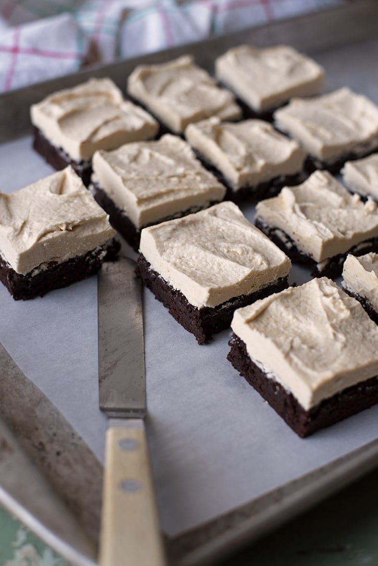 tray of brownies topped with frosting