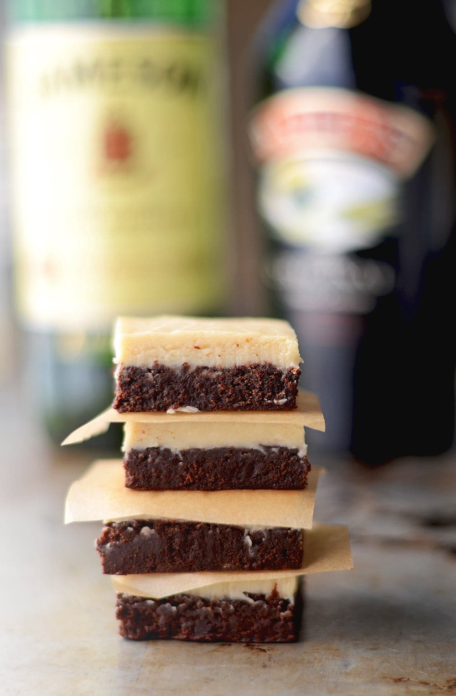 Boozy Irish Brownies have a fudgy chocolate layer that is topped with a whiskey and Irish cream white chocolate ganache. YUM! | vintagekitty.com