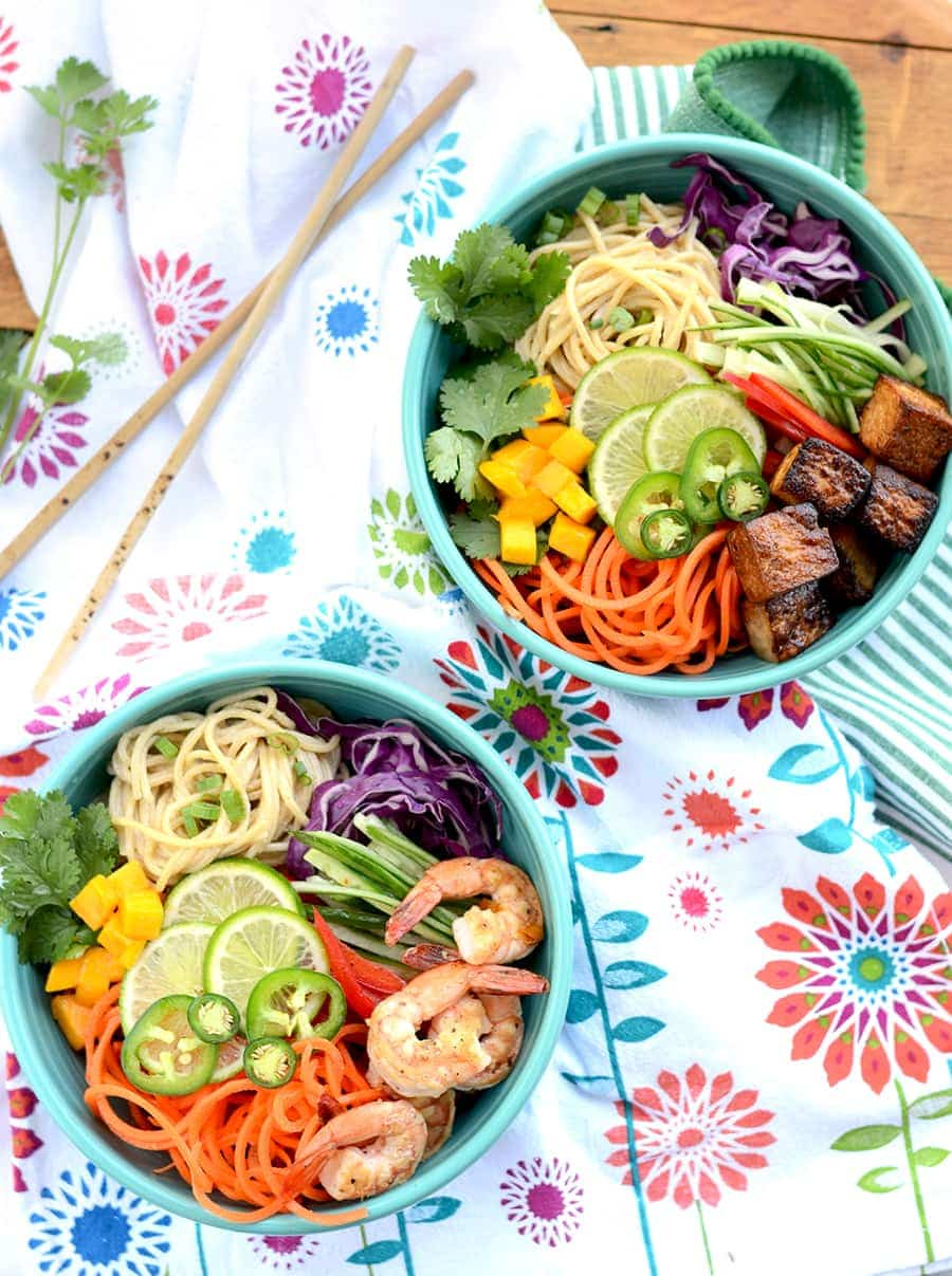 Sesame Noodle Salad Bowls with Cashew Dressing are ripe for summer! They are loaded with a rainbow of colorful fruits and vegetables. Recipe instructions for shrimp and tofu options.