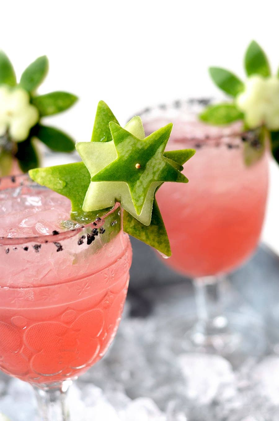 These fresh Watermelon Margaritas are trimmed with garnish made from the rind! Clever, tasty and made from scratch with fresh lime juice and watermelon.