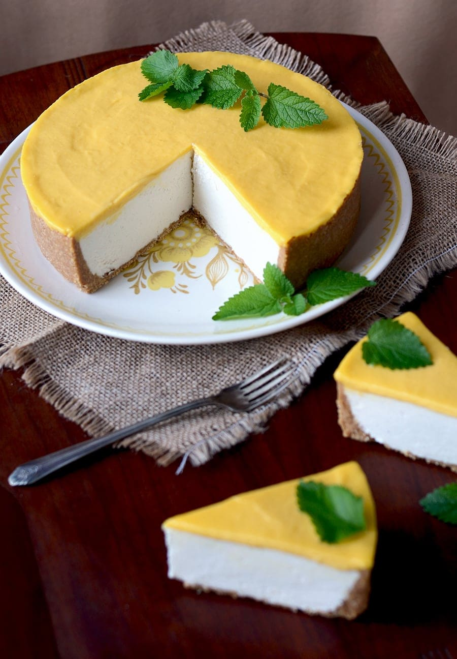 This Mango Lassi No Bake Cheesecake features a crunchy cashew coconut crust, a layer of yogurt cheesecake and a smooth mango curd topping.