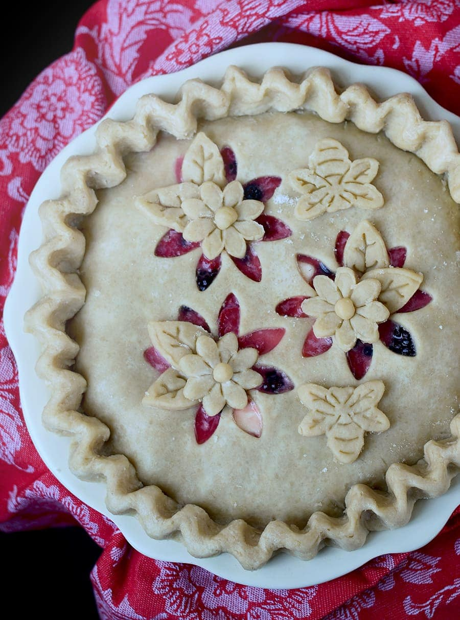 This Magnificent Mixed Berry Pie is the star of summer! Its buttery almond crust highlights summer's abundance of berries. Tender, flaky, and fruity!