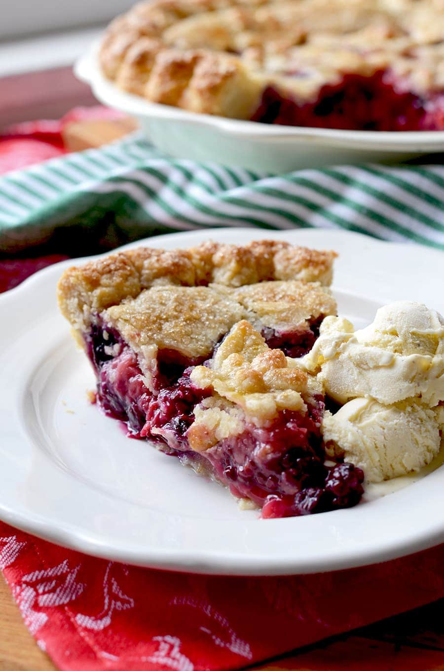 slice of mixed berry pie Web - Magnificent Mixed Berry Pie with Butter Almond Crust