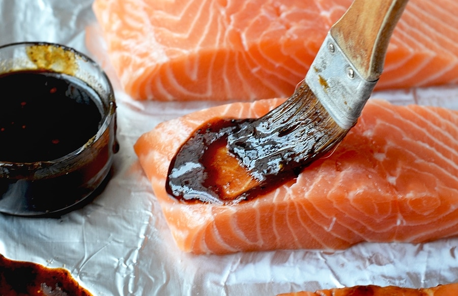 Basting glaze onto asian baked salmon
