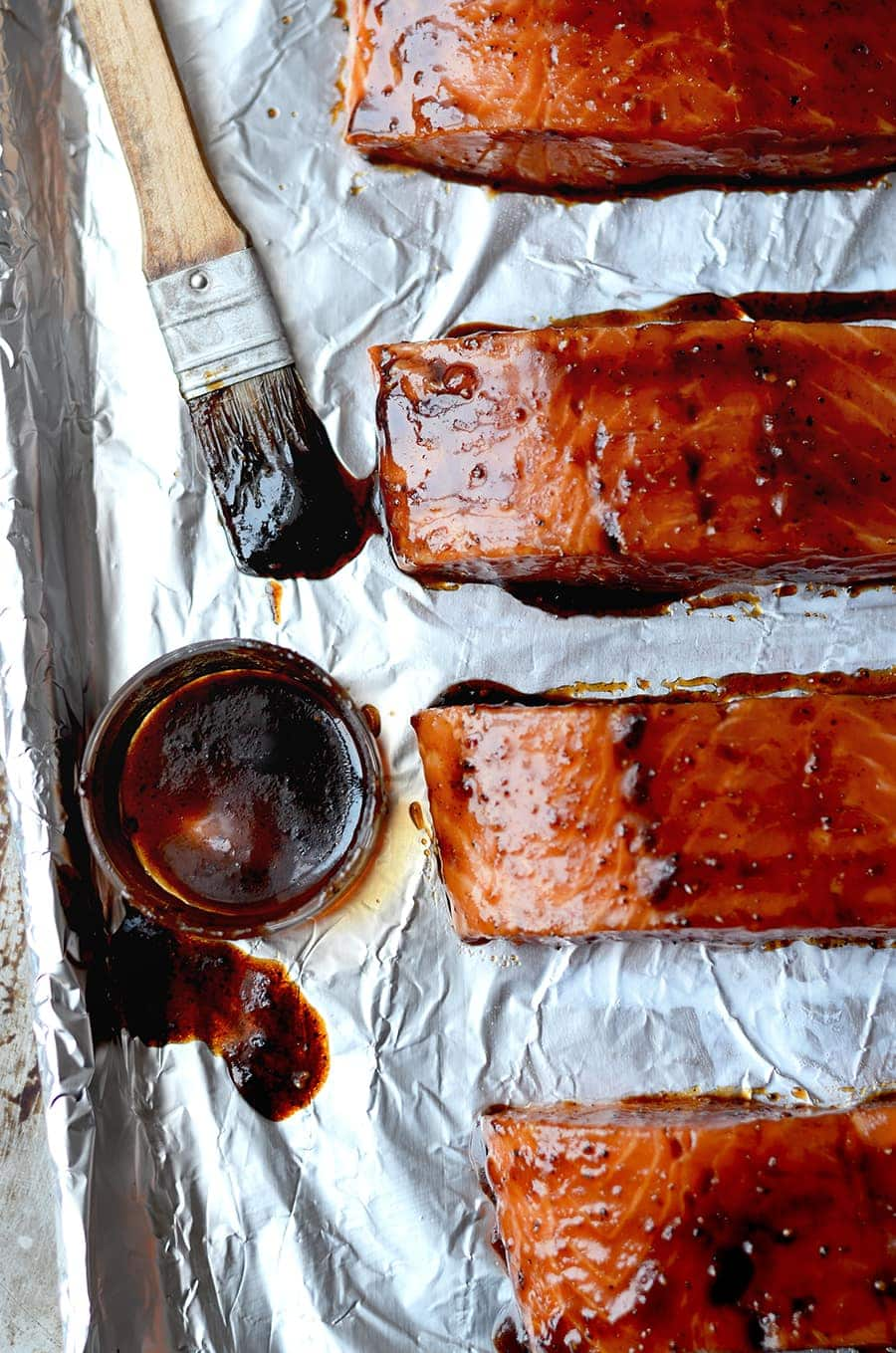 raw salmon glazed with sesame ginger glaze before baking
