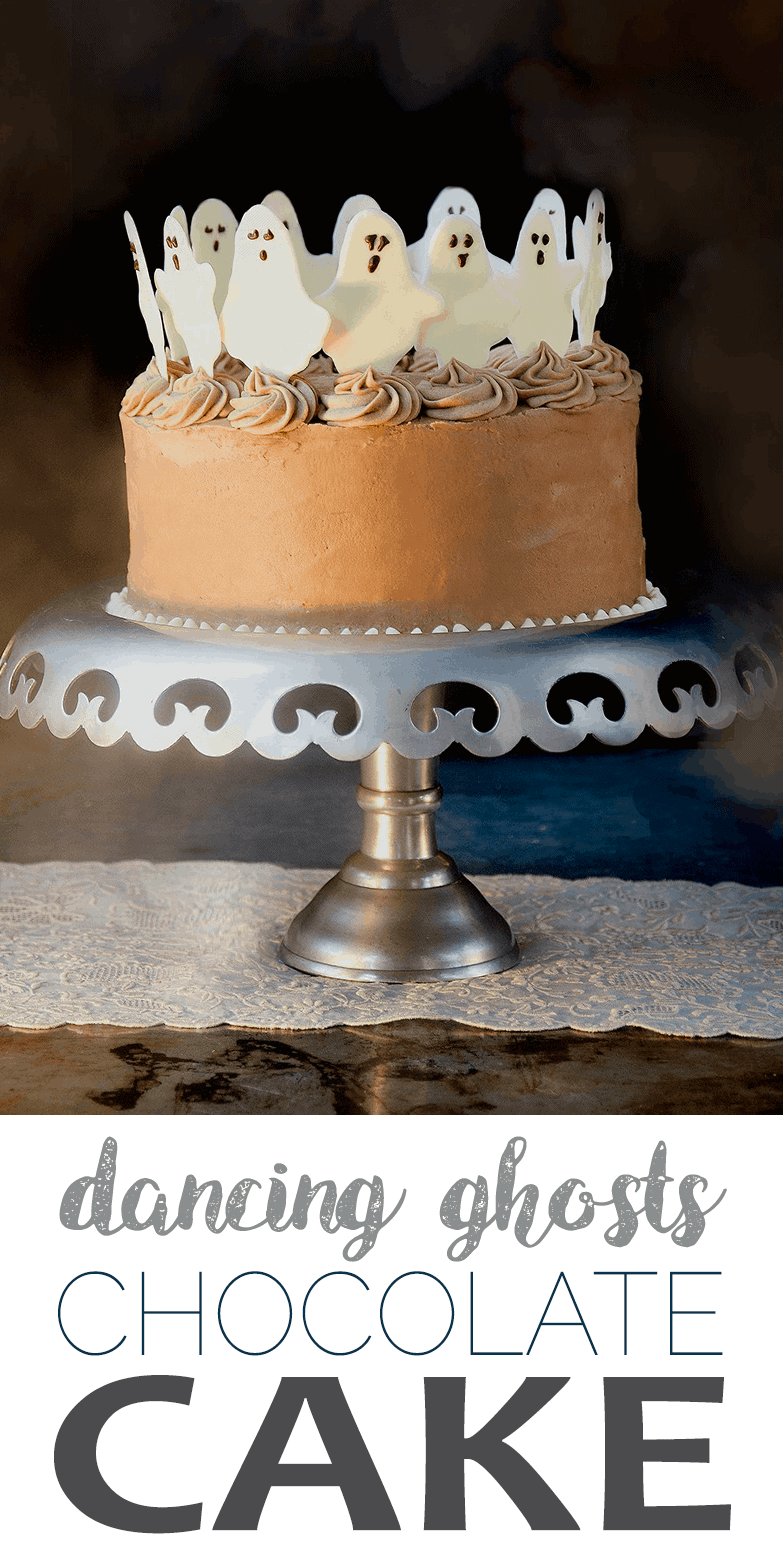 Boo! Dancing ghosts are the cutest Halloween cake topper EVER! Mocha coconut buttercream tops layers of fudgey chocolate coconut cake. HAUNTINGLY DELICIOUS! #halloween #chocolatecake #ghosts #cakedecorating #halloweenfood #halloweenparty