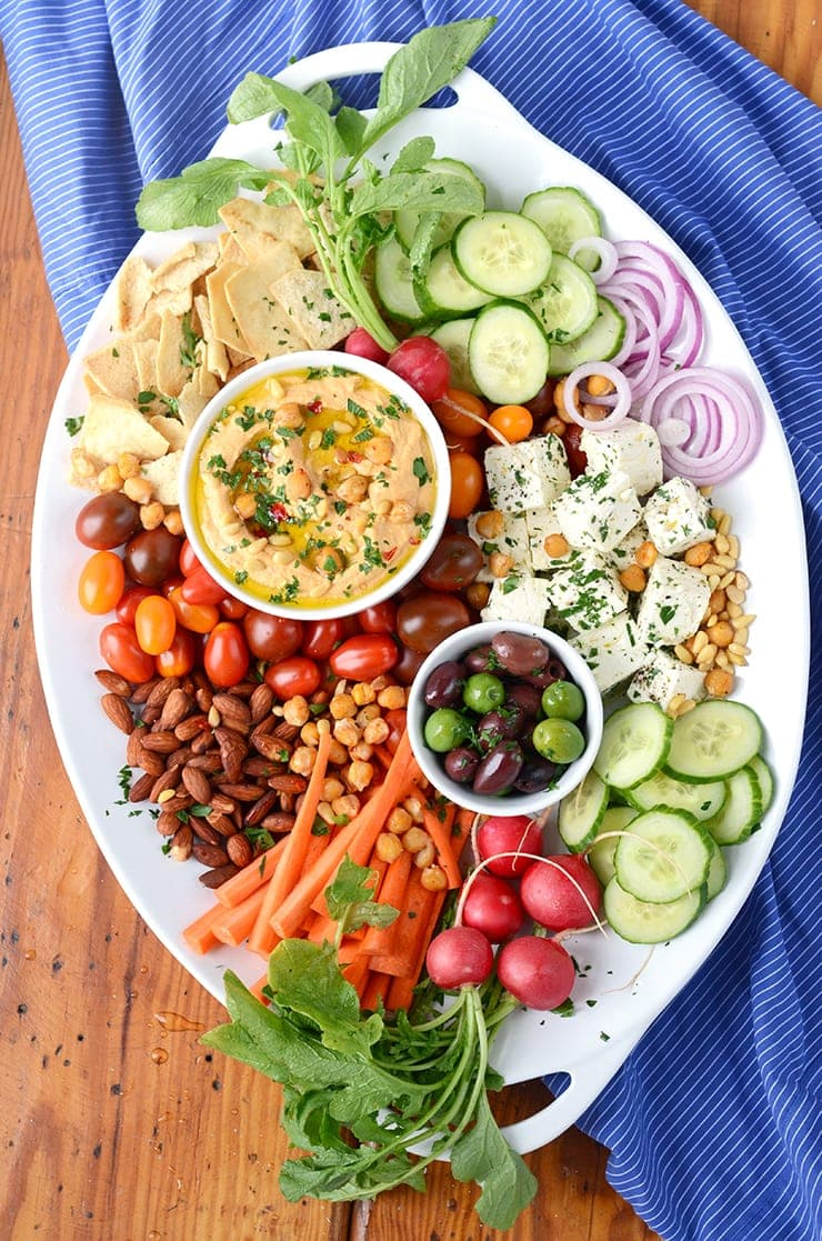 Become a party platter expert! This Harissa Hummus Recipe takes just 10 minutes to make so you have time to make an impressive tray of yumminess. Get our tips!