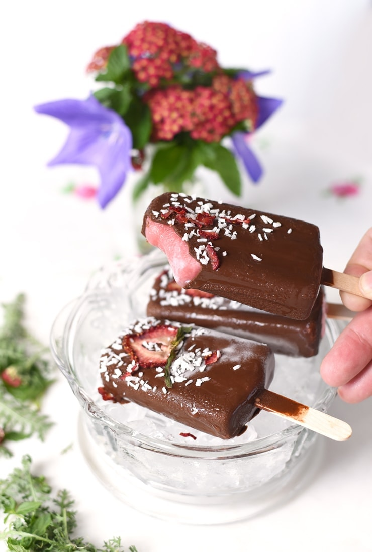 e is sweet with our homemade Chocolate Dipped Strawberry Coconut Popsicles. Frozen strawberry infused coconut milk pops drenched in a hard crack chocolate shell. YUM!