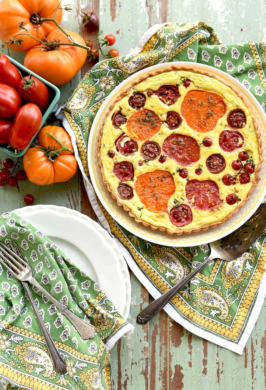 tomato tart filled with heirloom tomatoes of different colors and sizes