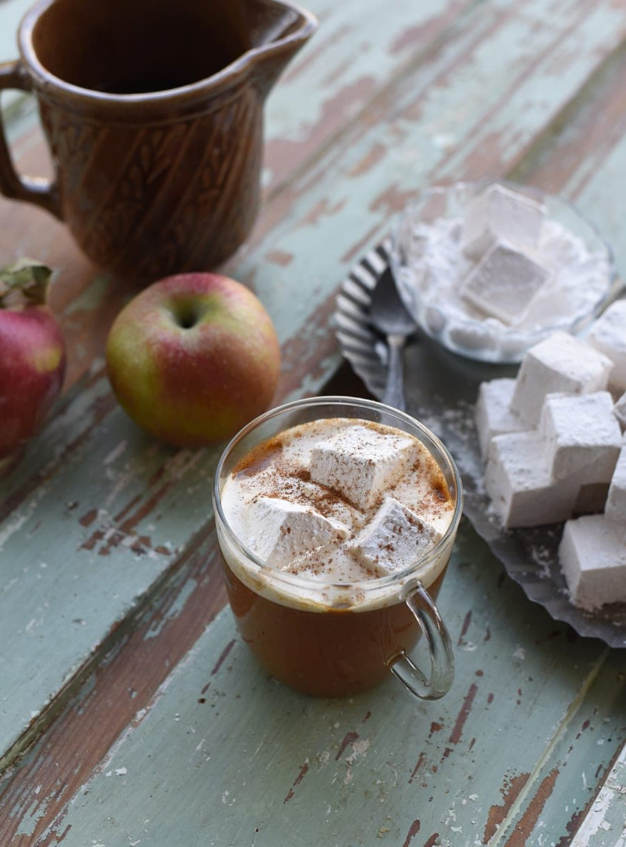 Mug of #hotcider with caramel apple marshmallows and cinnamon