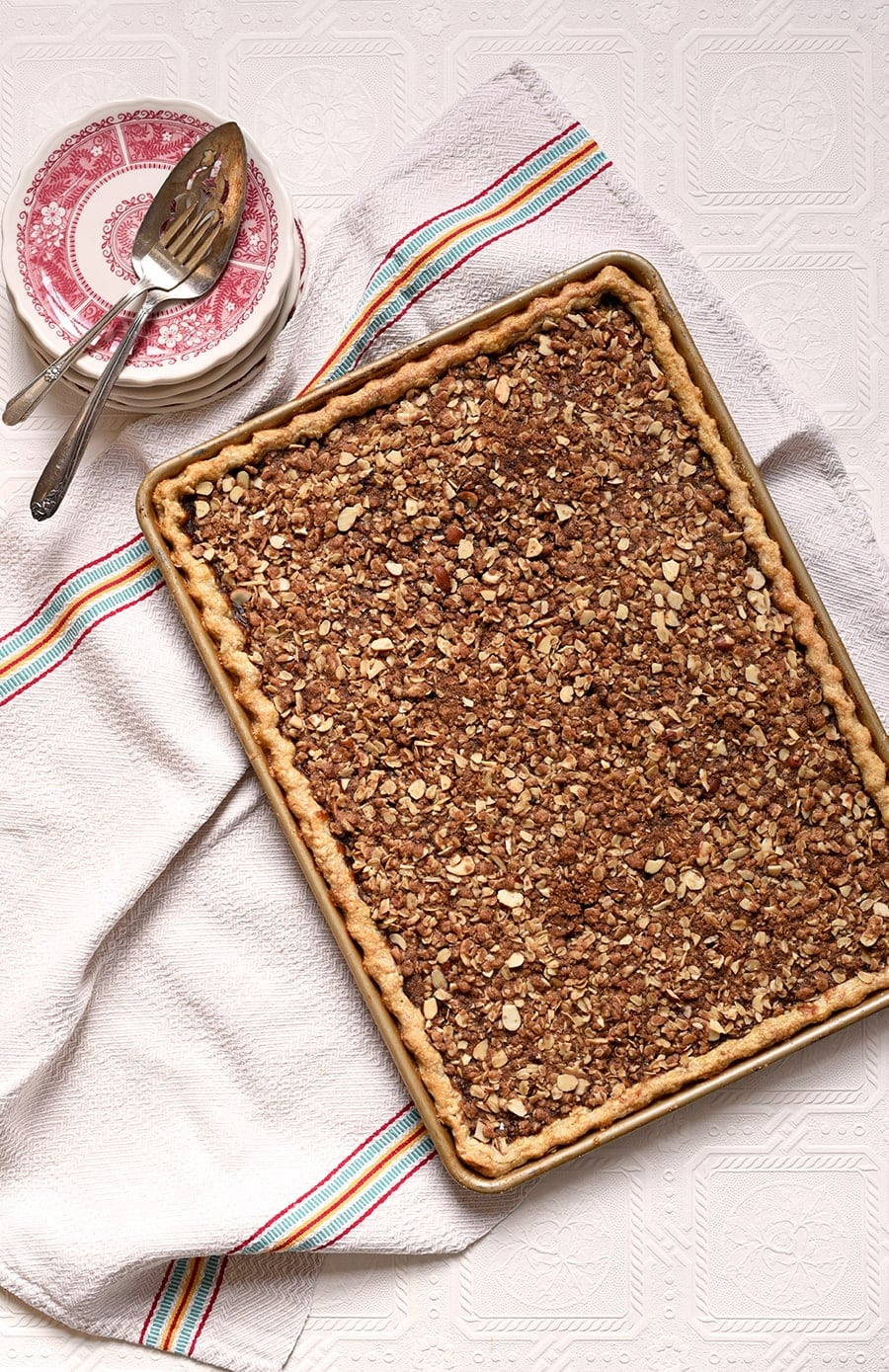 This slab pie has everything your sweet tooth desires! Flaky cinnamon crust...luscious apple butter...almond oat crumb. Plus no peeling apples!
