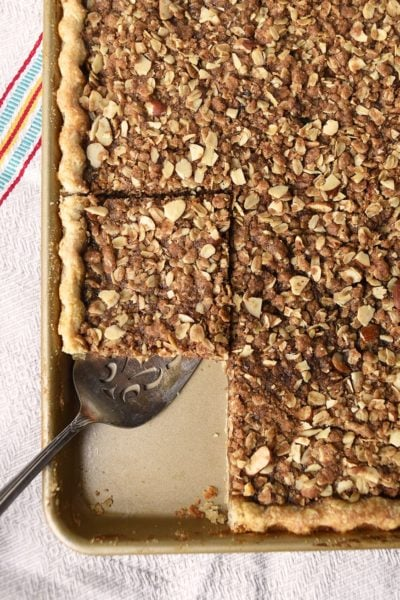 apple butter slab pie with crumb topping in square servings