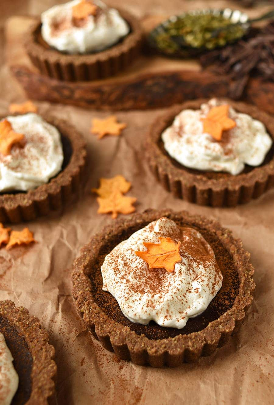 Pumpkin Chocolate Tarts with Pepita Crust are a delicious option for gluten-free, nut-free dinner guests this holiday season!