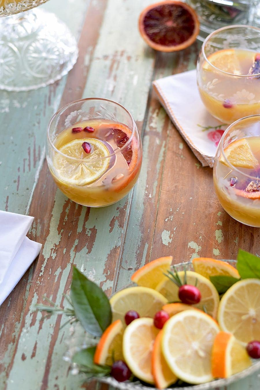 We've made some updates to this cocktail recipe, but you'll find that our Citrus Whiskey Tea Punch still has lots of old school charm. Bring on the holiday cheer! #christmaspunch #holidaypunch #holidaycocktail #christmasdrink