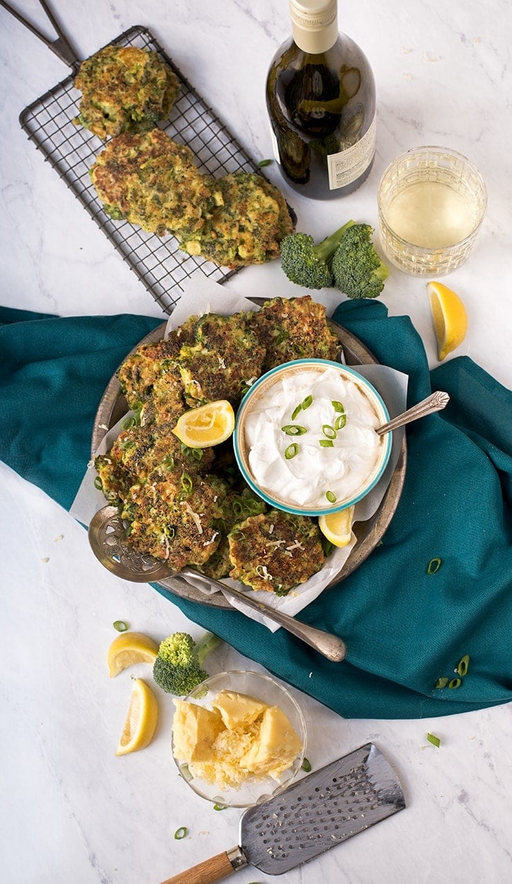 Looking for a meatless main course or a way to hide healthy vegetables? Either way, this cheesy broccoli fritters recipe is for you! Flavored with cheddar, scallions and garlic, these tasty broccoli fritters will make the meal. Great any time of day and easy to make. #vegetarian #broccoliandcheese #fritters