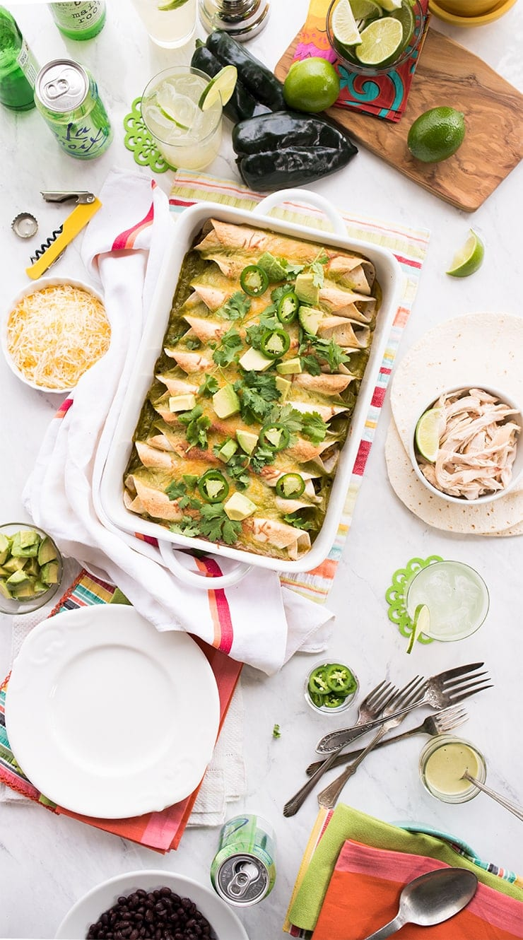 Poblano Sour Cream Chicken Enchiladas is a dish the whole family will love, from the kiddos to adults! This main course dish is naturally sweet, flavorful and ultra creamy! You're going to love the chicken and sweet potato filling that's rolled up and topped with homemade poblano sour cream sauce!!!! #chickenenchiladas #chickenrecipes #dinner #maindish #enchiladas #mexican #cincodemayo