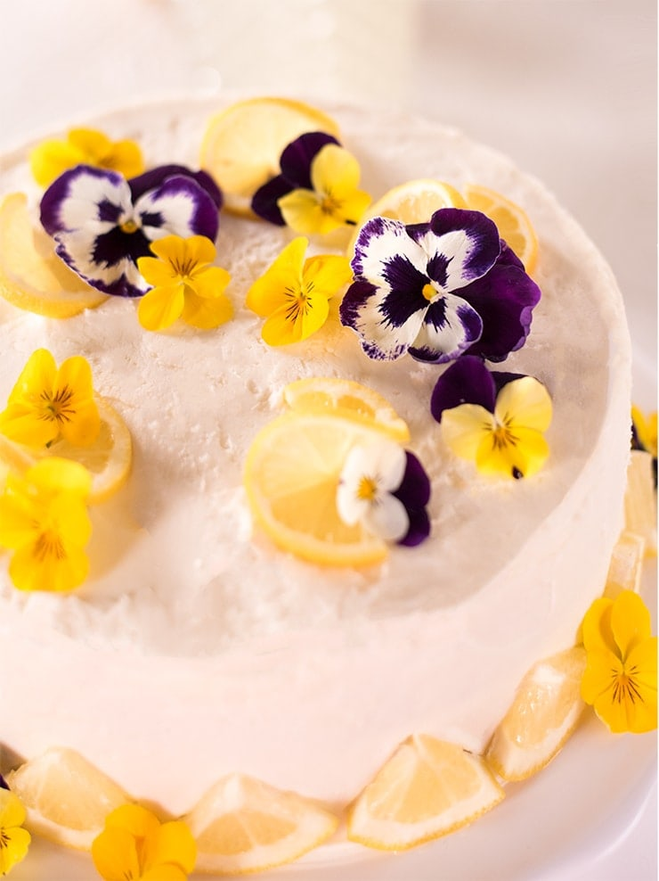 pansies and lemon slices on cake