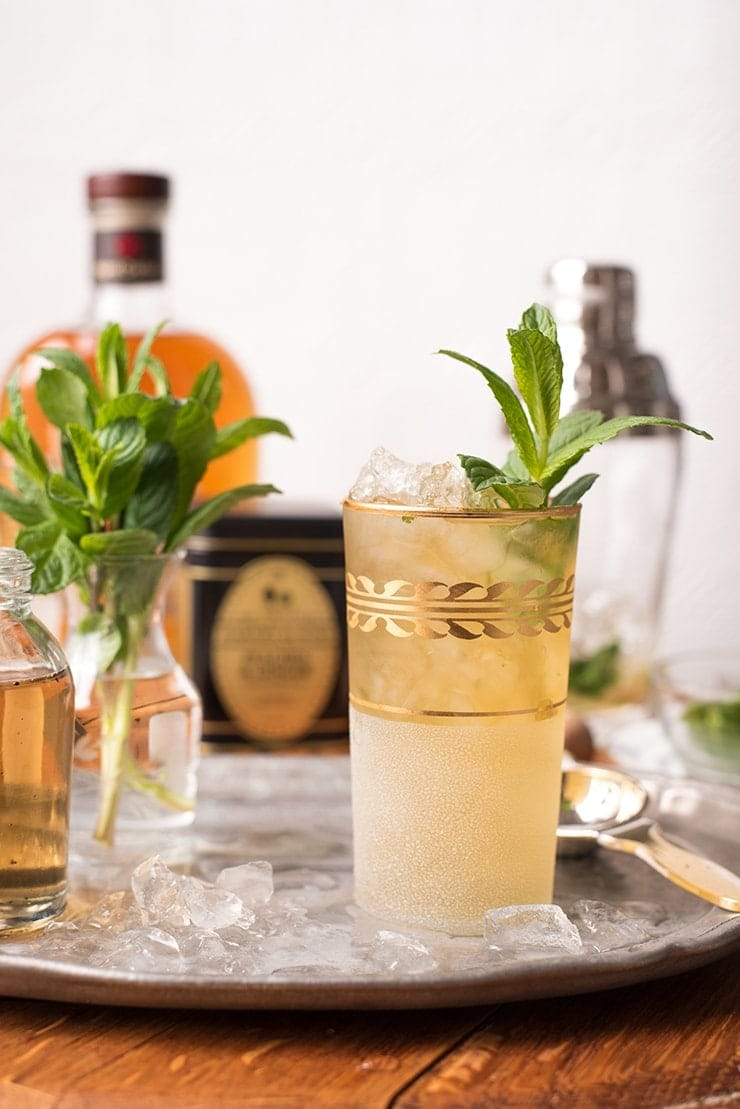 This peach tea mint julep is as refreshing as an iced tea but isn't too sweet. Subtle peach flavor mingles with bourbon and mint in a way that will impress even the most dyed in the wool southerner. #mintjulep #peachtea #cocktailhour #derbyday #summer #kentuckyderby #cocktailrecipes