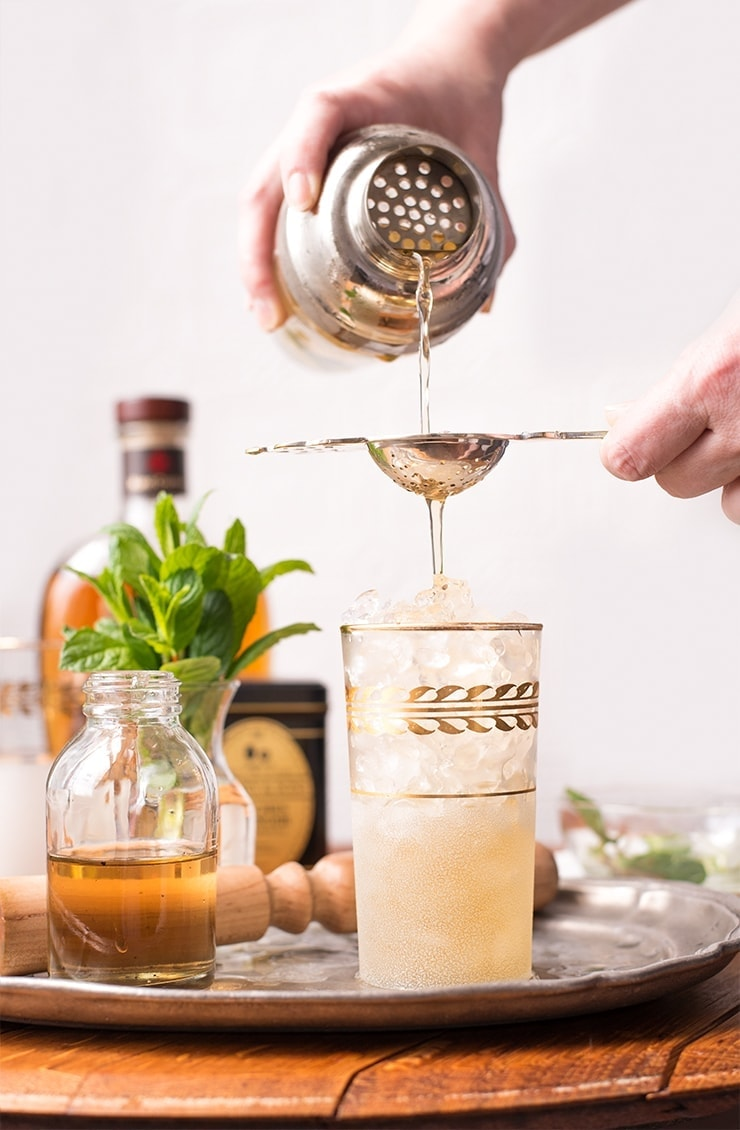 This cocktail is a mash up of peach iced tea and a mint julep. It's a modern drink with classic Southern roots and I think it's destined to be a new classic! Of course, it's perfect for Derby Day, but you'll find it fashionable 'til Labor Day! #mintjulep #peachtea #cocktailhour #derbyday #summer #kentuckyderby #cocktailrecipes