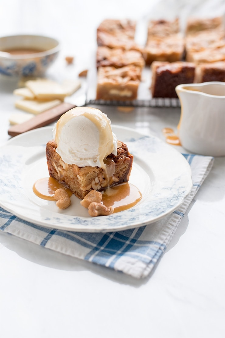 Our recipe for salted caramel blondies layered with chunks of white chocolate and cashews is truly magical! You are the dessert wizard and this will be you greatest spell! #dessert #blondies #saltedcaramel #recipe #cashews #whitechocolate #scratchbaking