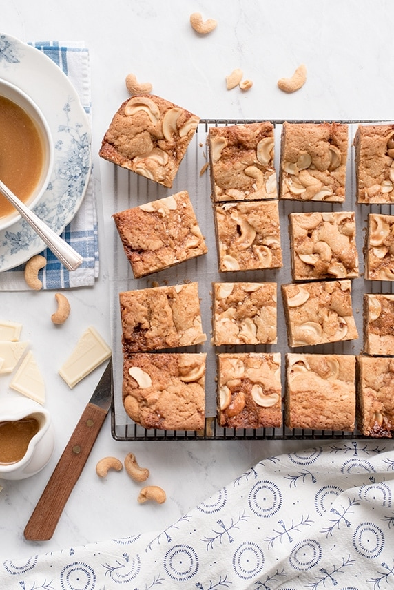 Caramel Blondies Closeup Pin 0773 - Salted Caramel Blondies with White Chocolate and Cashews