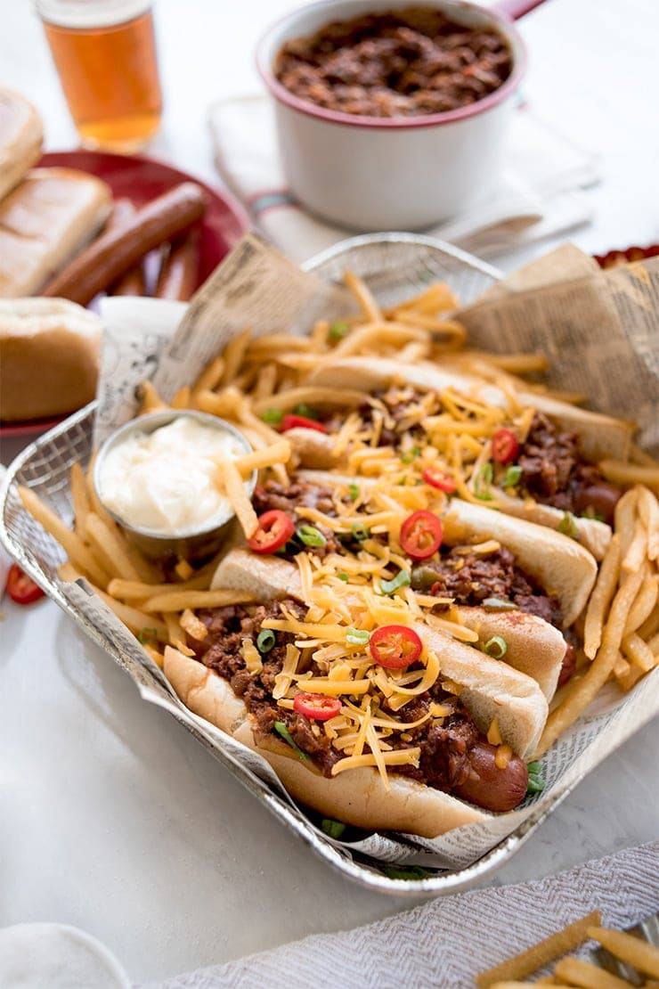 chili cheese dogs in a wire basket