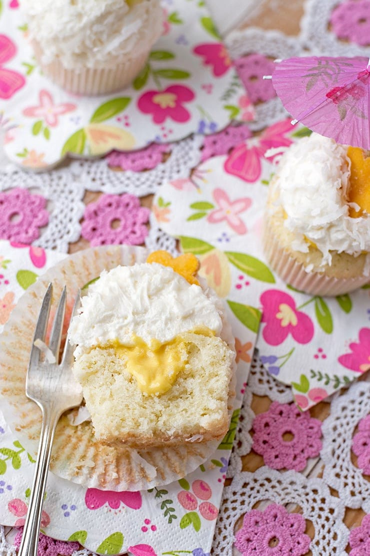 Coconut Cupcakes 1345 Cropped Web - Tropical Coconut Cupcakes with Mango Curd and Coconut Buttercream