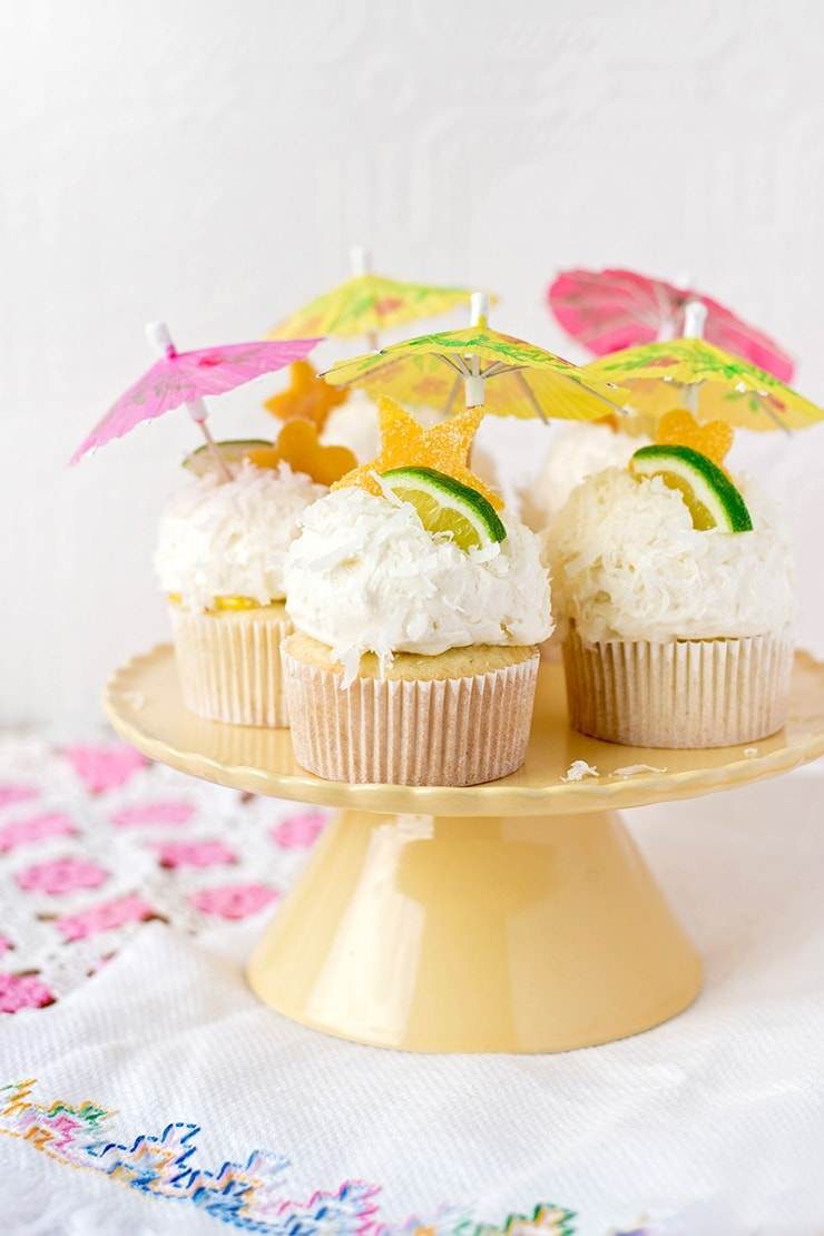 Tropical Coconut Cupcakes topped with cocktail umbrellas