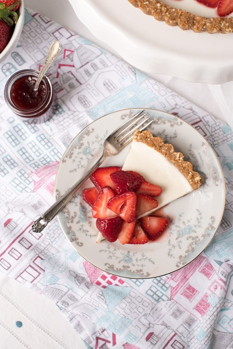 slice of panna cotta tart topped with strawberries
