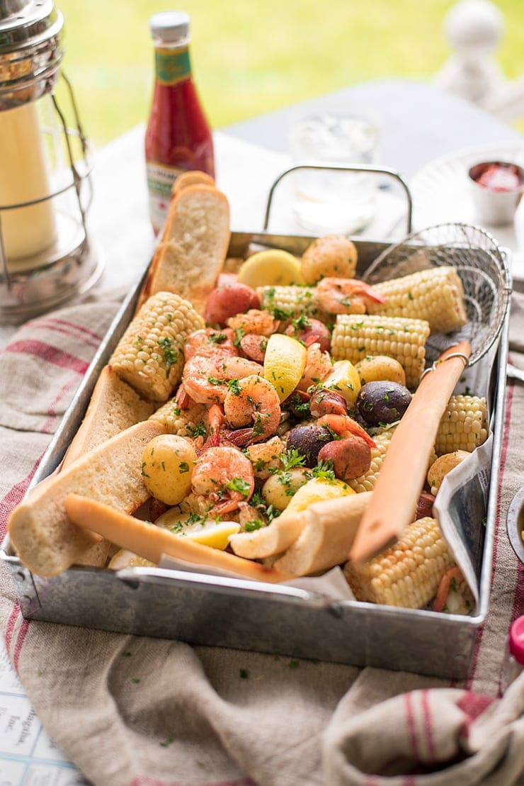 Tray filled with weeknight shrimp boil on table