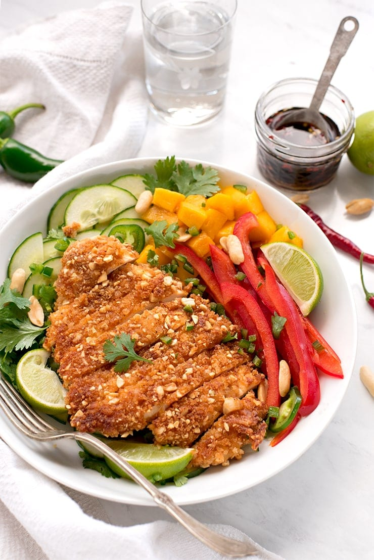 Keep the salad routine from getting boring. Crispy, pan-fried peanut chicken is your new weeknight dinner favorite! Serve it with this crunchy asian salad with an easy, homemade dressing. #peanutchicken #chickenrecipes #asiansalad #panfried #weeknightdinner #dinnerideas