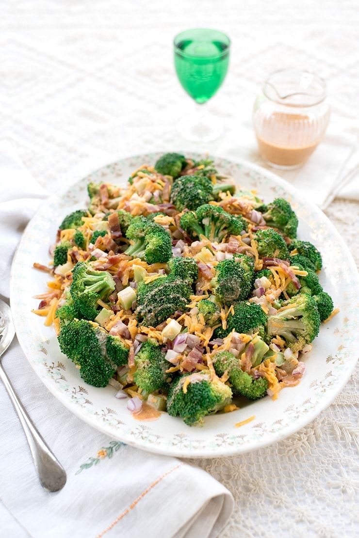 broccoli salad on a vintage china platter on a crocheted tablecloth