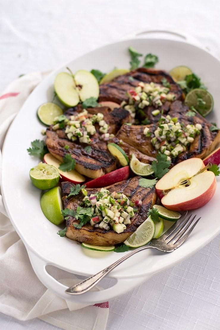 Platter of grilled pork chops with fesh apple salsa