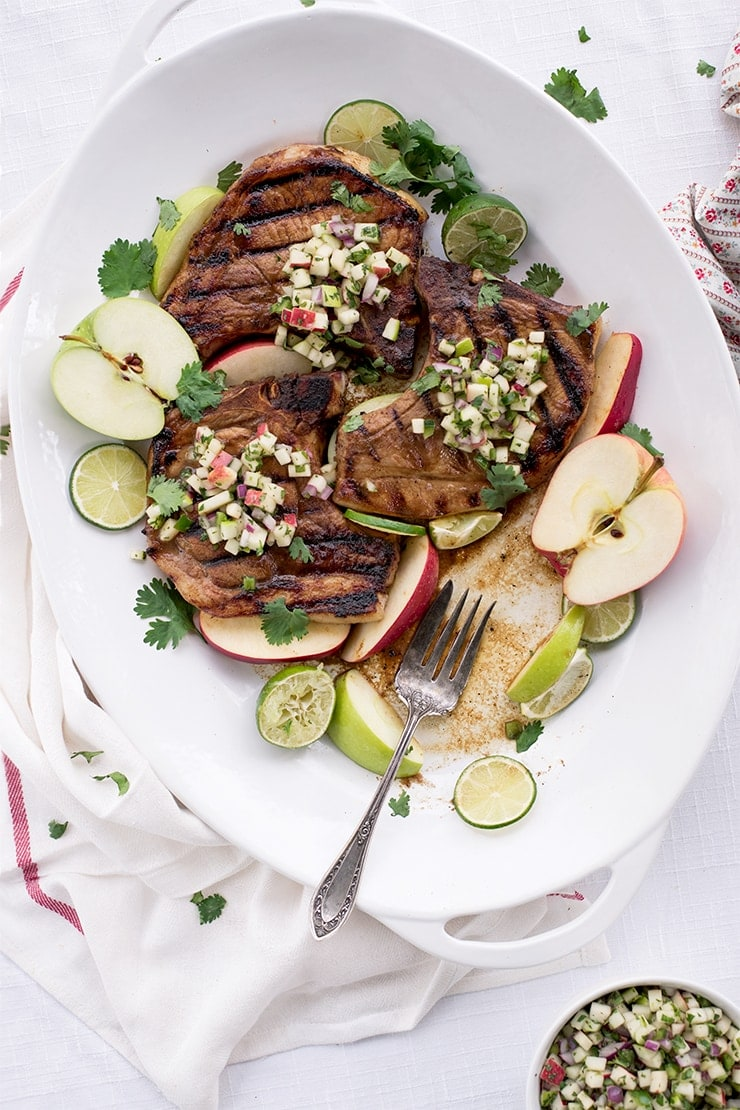 An apple butter glaze sears flavor into these juicy grilled pork chops while adding a fresh apple salsa makes this dinner a surefire hit. Weeknight or weekend, this autumn main course might become a staple year-round!