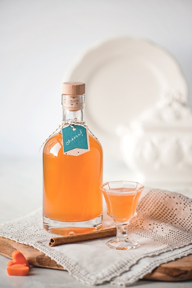 Carrot cake liqueur on a crocheted cloth