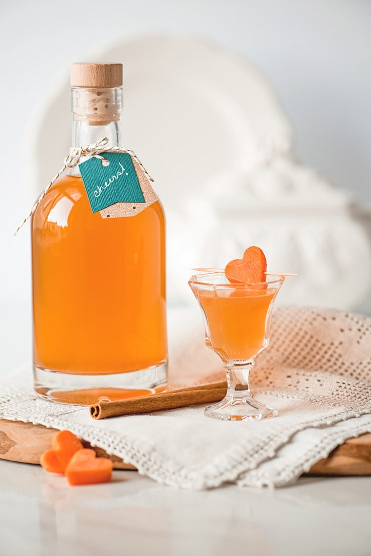 Carrot cake liqueur is a delicious after dinner drink infused with sugar and spice and everything nice. It's easy to craft and perfect for homemade gifts! #liqueur #aperitif #homemadeliqueur #cocktailhour #cocktails#homemadegifts #carrotcake #vodka