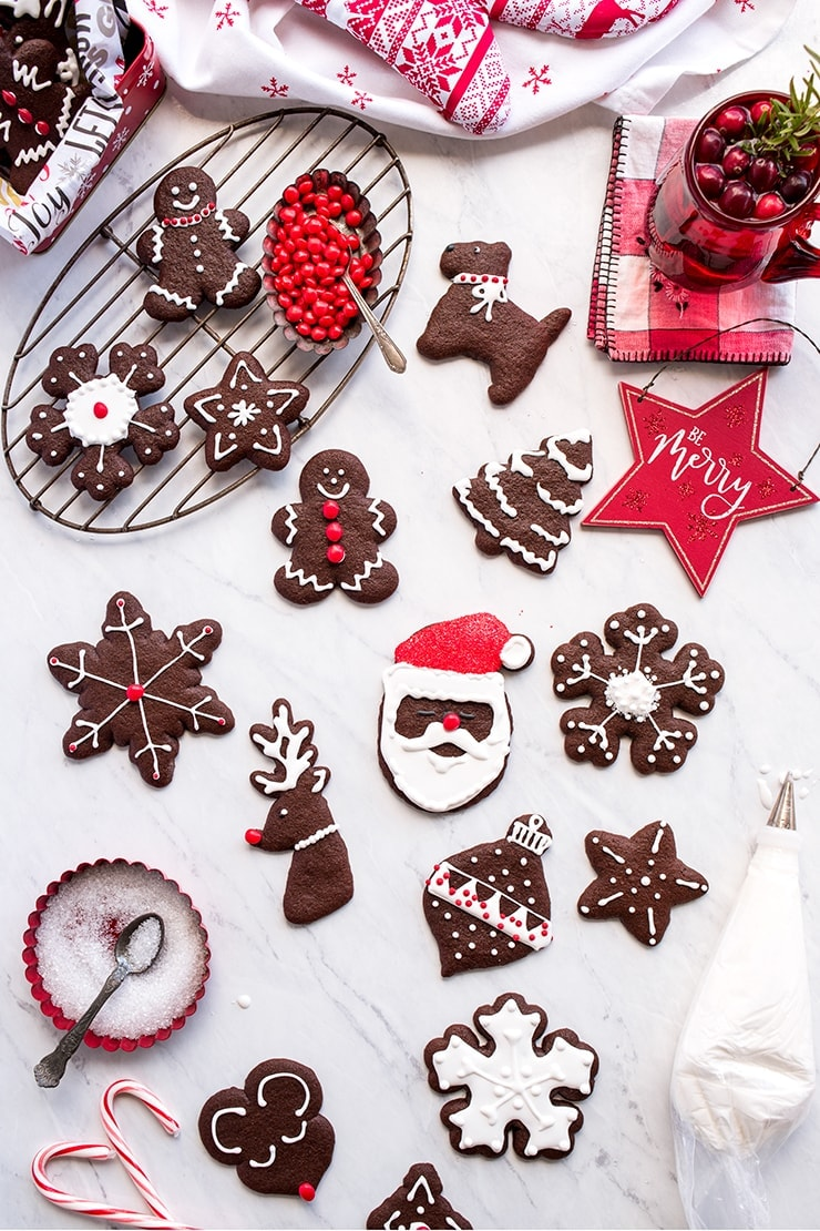 Christmas decorated chocolate gingerbread cookies on marble