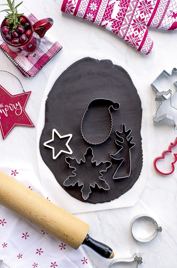 Cutting rolled out Chocolate gingerbread dough with cookie cutters