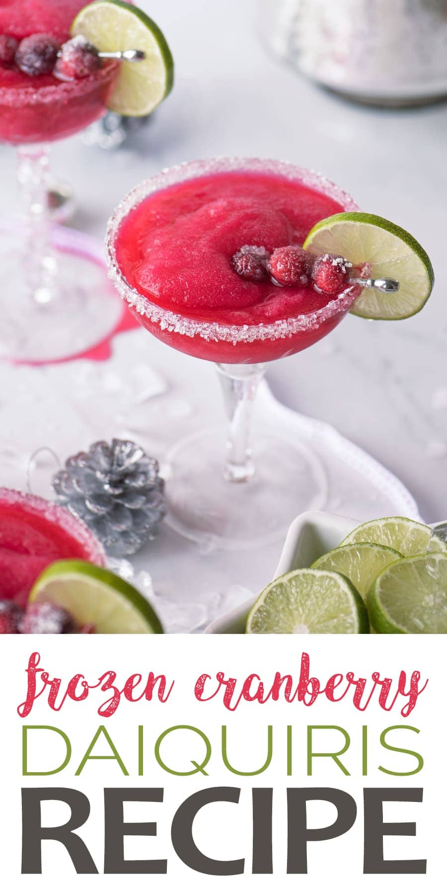 Baby it's cold inside with these frozen cranberry daiquiris! It's a festive holiday twist on the classic daiquiri that's sure to make your holiday a blast! #cocktails #cranberry #daiquiri #cocktailhour #christmascocktails #christmasparty