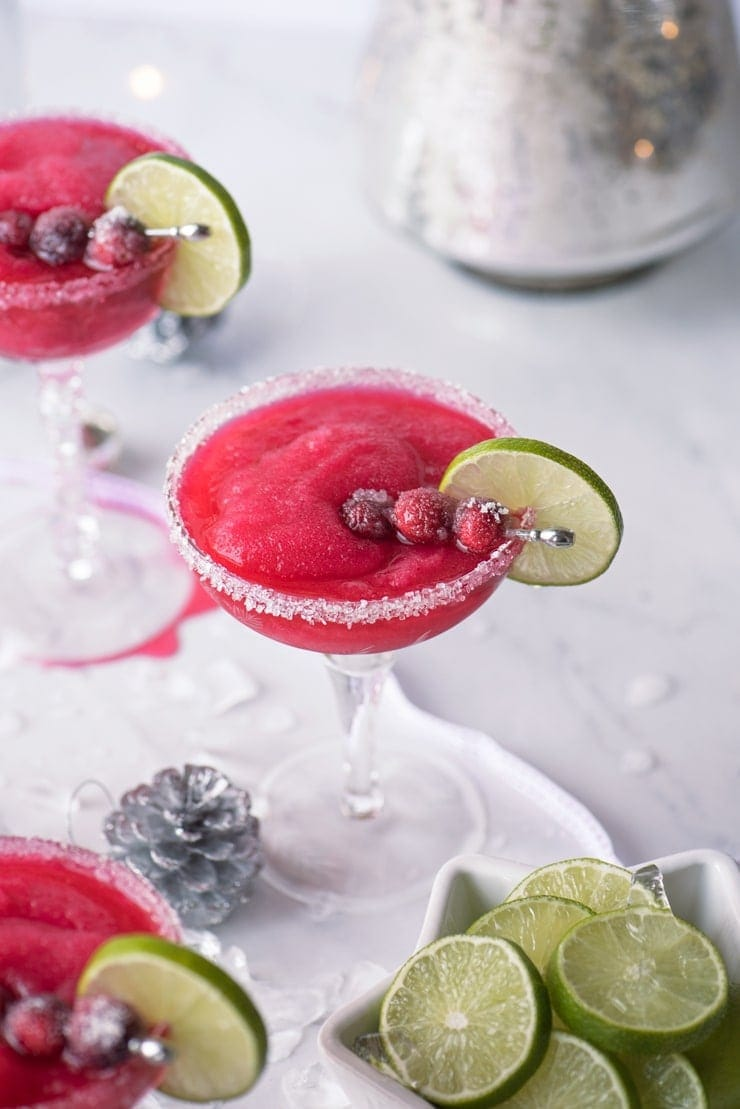 glass filled with frozen cranberry daiquiri with lime