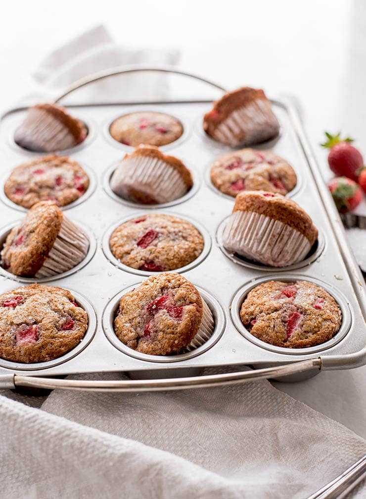 bakery style strawberry muffins in baking pan